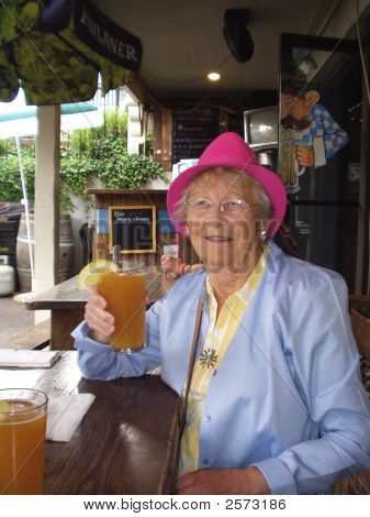 Senior Woman With Beer Glass raised