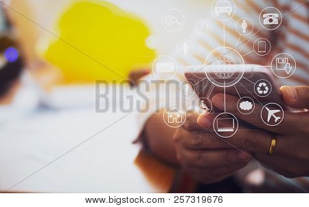 Architecture In Casual Dress Holding Mobile Phone With Online While Making Orders With Virtual Icon