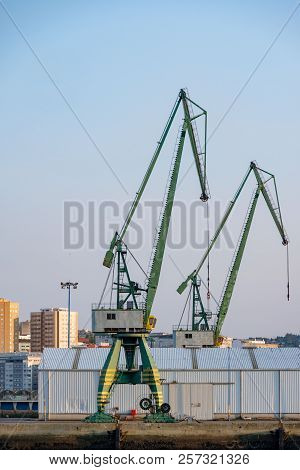 Two Heavy Cranes For Loading Merchant Ships In The Port Of La Coruna In Spain