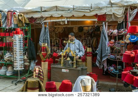 Cairo, Egypt February 18, 2017. Shop Selling Hats Called Fez Or Tarbush And Egyptian Headdresses Wit