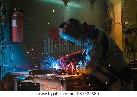 Metal Welding Worker In Working Process And Fire