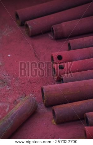 Abstract Red Metall Pipe On The Floor