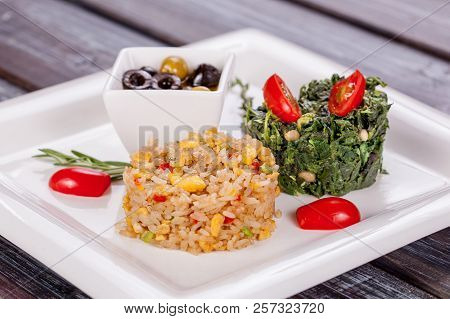 Vegetarian Rice Dish With Vegetables And Spinach Stewed With Nuts