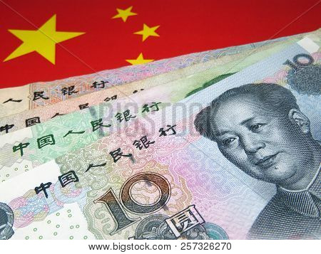 Yuan On Background Of National Flag Of China. Concept For Chinese Economy