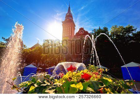 Subotica city hall and fountain sun haze view, Vojvodina region of Serbia poster