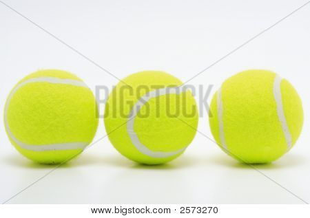 three yellow tennis balls on white surface poster