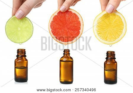 Set With Citrus Essential Oils On White Background
