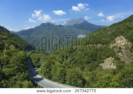 Aerial View Of The Greenery Of The Mountain Massifs Of Montenegro And The Road, Serpentine Winding A