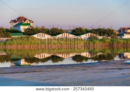 River Town Houses Reflection In Water Landscape. View River Town Houses Scene. River Town Houses Pan