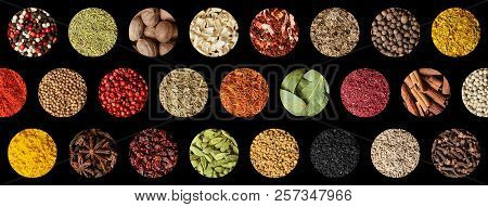 Spice Collage Background. Assortment Of Spices Herbs And Condiments Isolated On Black Top View.