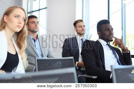 Group Of Businessmen Sitting In Conference To Speech While Having Business Meeting.