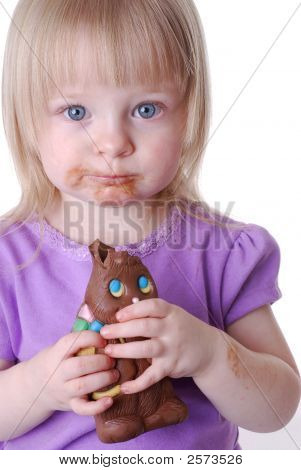Little Girl Eating An Easter Chocolate Bunny