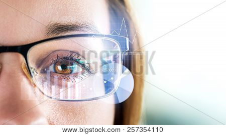 Smart Glasses And Augmented Reality Concept. Woman Wearing Modern Spectacles With Futuristic Screen.