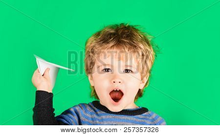 Happy Boy Playing With Paper Plane. Child Playing With Paper Airplane. Small Boy Throwing Paper Plan
