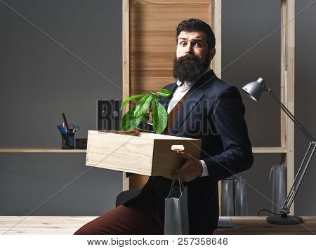 Dismissed Employee In Suit With Belongings. Getting Fired. Last Day At Work. Upset Office Worker Is