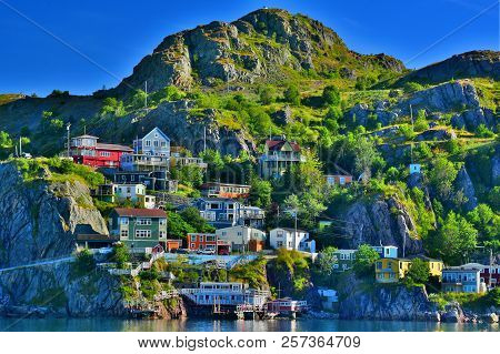 An HDR Image of The Battery Neighbourhood at sunrise, St John`s harbour, Newfoundland, Canada