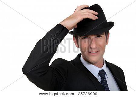 Businessman wearing trilby