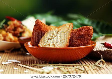 Coxinha Street Food. Brazilian Chicken Coxinha Over Rustic Background.