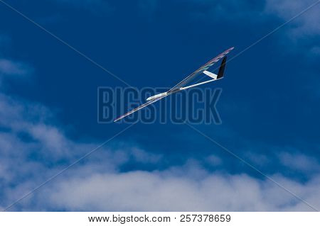RC remotely controlled soaring plane model sailplane on blue sky in brisk wind poster