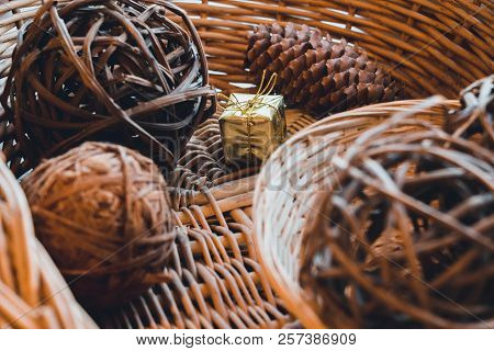 In A Basket That Is Woven From A Vine, There Are Balls That Are Also Woven From A Vine And Cone Of C