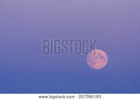 Full Moon, A Lunar Phase, On The Colorful Sky. Late Evening Up North Close To Midnight.