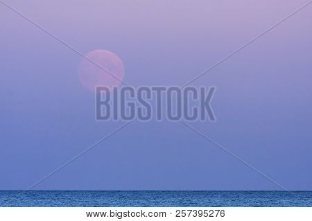Full Moon, A Lunar Phase, Above The Sea. Late Evening Up North. Colorful Sky.