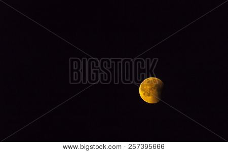 Full Moon, A Lunar Eclipse, On The Black Sky. Late Evening, Night Up North Close To Midnight.