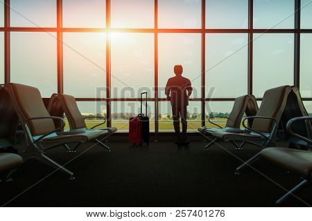 Passenger Seat In Departure Lounge For See Airplane, View From Airport Terminal. Sun Light In Vintag