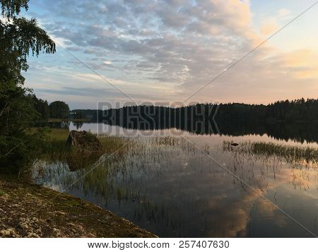 Beautiful Sunset On The Lake, Karelian Nature, Stone Shore, Reeds In The Water, Coniferous Shore On