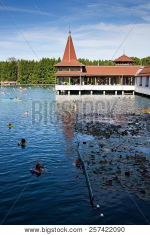 HEVIZ, HUNGARY - 18 AUGUST, 2018: People bathing in lake Heviz in Hungary.  Lake Heviz is the world's second-largest thermal lake, but biologically the biggest active natural lake