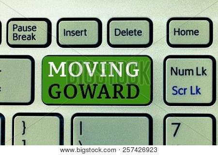 Word writing text Moving Goward. Business concept for Towards a Point Move on Going Ahead Further Advance Progress poster