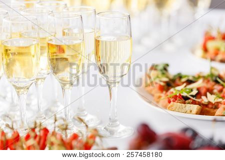 Bartender Pouring Champagne Or Wine Into Wine Glasses On The Table In Restaurant. Solemn Wedding Cer