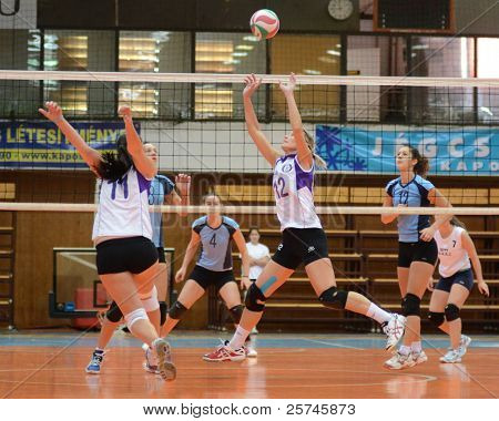 KAPOSVAR, HUNGARY - OCTOBER 16: Unidentified players in action at the Hungarian NB I. League woman volleyball game Kaposvar (blue) vs Ujpest (white), October 16, 2011 in Kaposvar, Hungary.