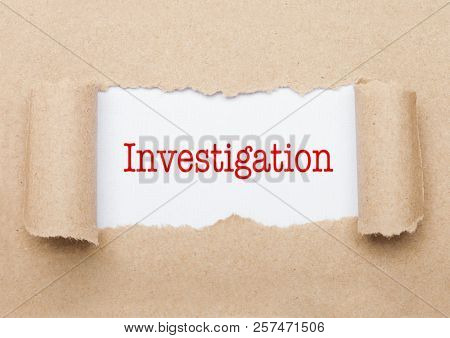 Investigation Concept Text Appearing Behind Torn Brown Paper Envelope