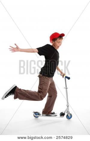 Happy Boy Riding A Scooter