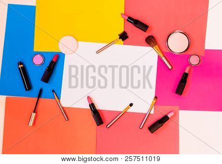 Makeup Cosmetics And Brushes On Colorful Paper Background