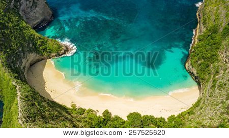 Aerial panorama over the Kelingking beach and coastline in Nusa Penida island, Bali, Indonesia
