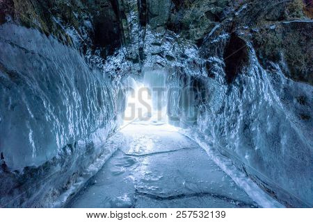Winter Landscape, Frozen Ice Cave With Bright Sunlight From Way Out At Frozen Lake Baikal In Siberia