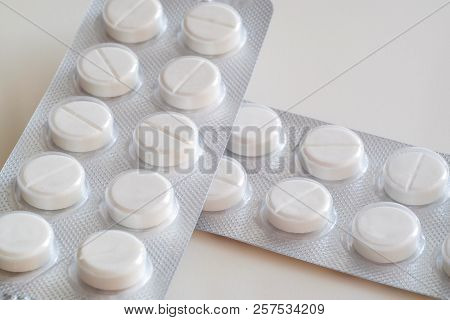 Medication Pills. White Pills, White Background. A Jar Of Pills