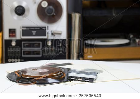 Vinyl Record With Copy Space In Front Of A Collection Albums Dummy Titles. Reel Tape Recorder. Audio