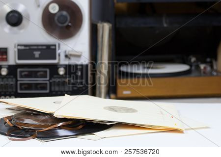 Vinyl Record With Copy Space In Front Of A Collection Albums Dummy Titles. Reel Tape Recorder