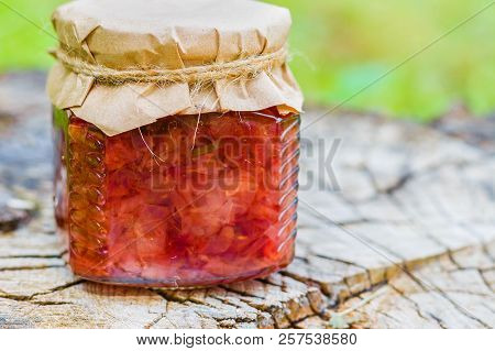 Jam From Rose Close-up. Bank With Jam On A Wooden Stump