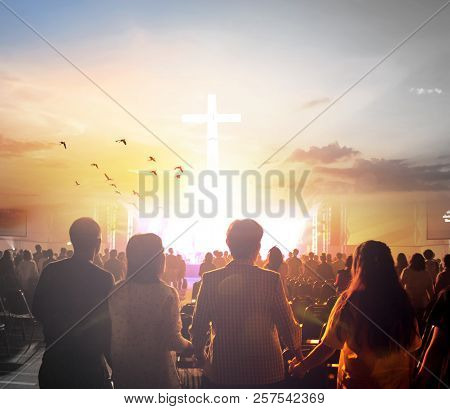 International Day Of Peace:silhouette Of Man Raised Hands At  Sunset  Background