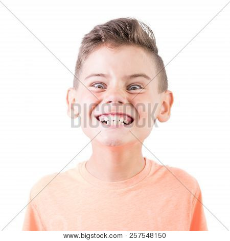Portrait Of A Cute Happy Grin Boy Isolated On White Background. Funny Emotional Teenager Looking At