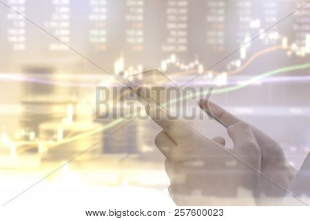 Double Exposure Of Business Woman Using Smartphone Trading Stock With Blurry Stock Chart Background.