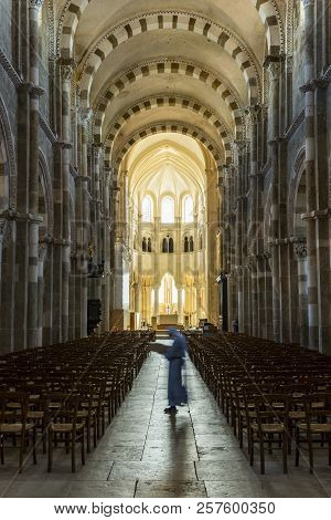 Vezelay, France - July 29, 2018: Church Interior With Nun Walking In The Romanesque Abbey And Church