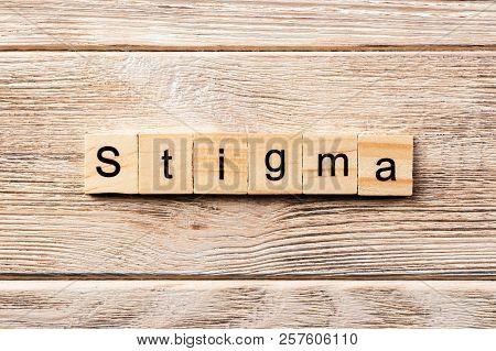 Stigma Word Written On Wood Block. Stigma Text On Table, Concept.