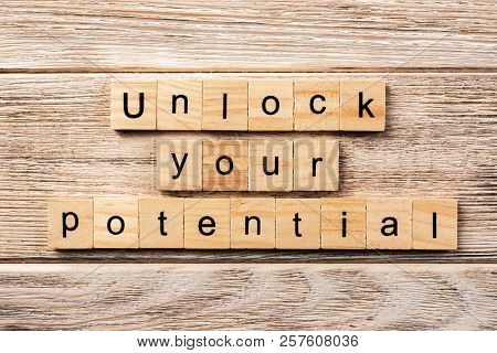 Unlock Your Potential Word Written On Wood Block. Unlock Your Potential Text On Table, Concept.