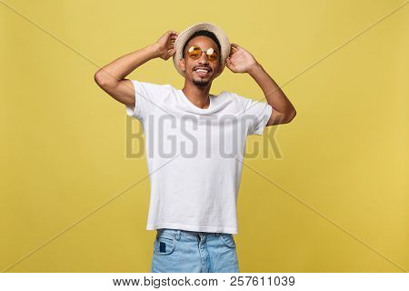Close Up Portrait Of Young Afro American Shocked Tourist , Holding His Eyewear, Wearing Tourist Outf
