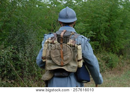 A Back View Of A 1918 French Soldier In The Countryside